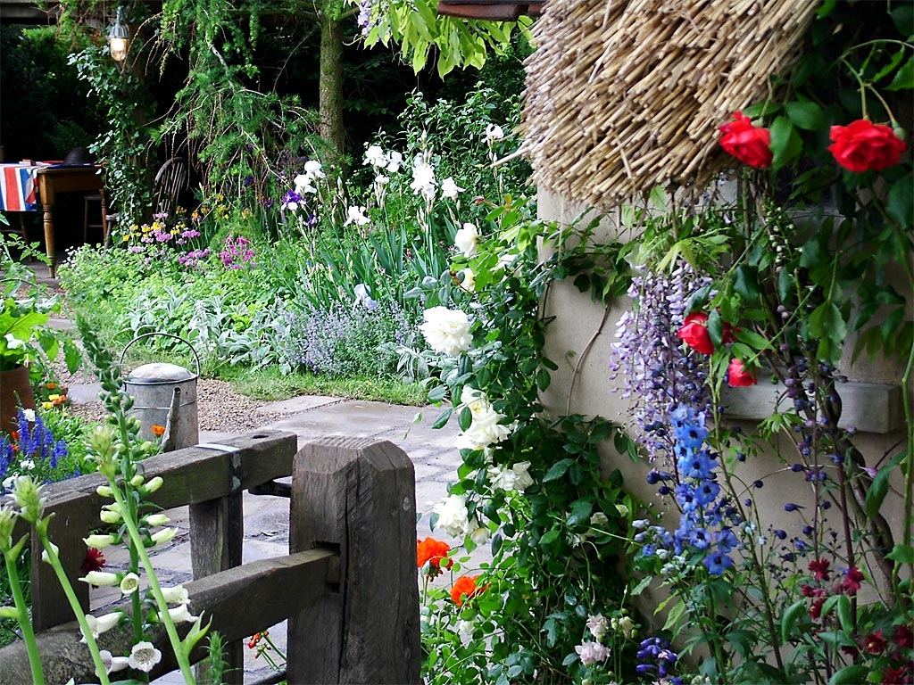 Rustic country flower gardens for Classic house with flower garden